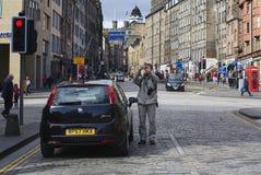 Il turista sta facendo l'immagine sul miglio reale Immagini Stock Libere da Diritti