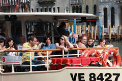 Il Vaporeto. Venice,Italy- July 28th, 2011: Image of tourists during a trip with \'Il Vaporeto\ on the Grand Canal in Venice. Il Vaporeto is a motorised waterbus Stock Image