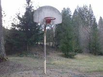 Il vecchio cerchio della palla del canestro Immagine Stock
