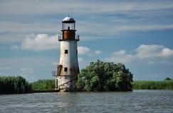 Il vecchio, faro abbandonato di Sulina, delta di Danubio fotografia stock
