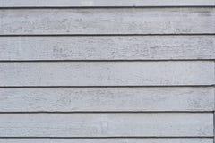 Il vecchio gray stagionato ha dipinto la struttura di legno del fondo della parete Immagini Stock