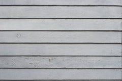 Il vecchio gray stagionato ha dipinto la struttura di legno del fondo della parete Fotografia Stock Libera da Diritti