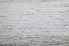 Il vecchio legno coperto di bianco ha screpolato la struttura della pittura fotografia stock