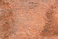 Il vecchio muro di mattoni con molte pietre immagine stock