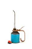 Il vecchio olio può con l'automobile del giocattolo Fotografie Stock