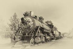 Il vecchio treno nello stile d'annata fotografia stock