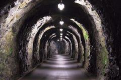Il vecchio tunnel si è acceso scarsamente nelle alpi svizzere Fotografia Stock Libera da Diritti