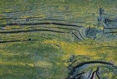 Il vecchio verde sbiadito naturale di legno stagionato ed il giallo hanno dipinto il fondo Fotografia Stock Libera da Diritti