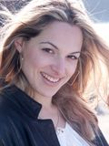 Il vento salta i capelli della ragazza bionda Fotografia Stock Libera da Diritti