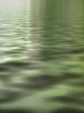 Il verde innaffia surreale Immagine Stock