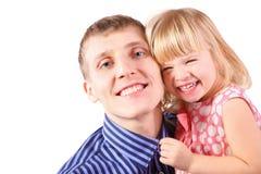 Il vestito da portare dalla bambina è abbraccio il suo padre Immagine Stock Libera da Diritti