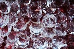 Il vetro gradisce i diamanti gioielli, fondo Fotografia Stock