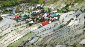 Il villaggio alloggia vicino ai campi dei terrazzi del riso Banaue, Filippine Immagine Stock