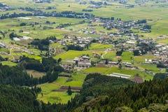 Il villaggio e l'agricoltura di Aso sistemano in Kumamoto, Giappone fotografie stock
