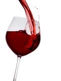 Il vino rosso ha versato dentro un vetro Fotografia Stock Libera da Diritti