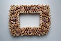Il vino tappa la cornice strutturata fotografia stock