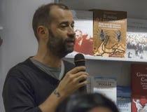 Il volo di Fabio parla il microfono Fotografie Stock