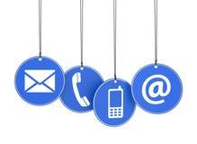 Il web ci contatta icone sulle etichette blu Fotografia Stock