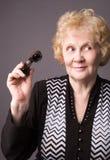 Il witn anziano della donna binoculare. fotografia stock
