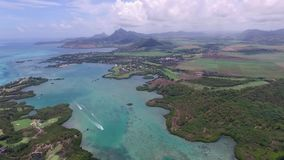Ile aux Cerfs, Deer Island from above. Landscape with ocean and tree in background. Mauritius stock footage