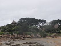 Island aux oiseaux - Trees and rocks - Bretagne. The Ile aux oiseaux is a small island of the Gulf of Morbihan belonging to the state. She is managed by the Stock Photos