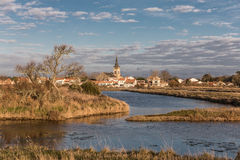 Ile d`Olonne bell tower seen from the salt marshes Royalty Free Stock Photos