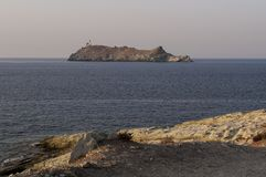 Ile de Ла Giraglia, остров Giraglia, маяк, Barcaggio, Ersa, крышка Corse, накидка Corse, haute-Corse, Корсика, Франция, Европа стоковое изображение rf
