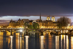 Ile de la cité and pont des arts  with cathedral in Paris by night - France Stock Photo