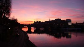 Ile de la Cite at Dawn. A dramatic dawn sky over Ile de la Cite and Pont Neuf in Paris surrounded by a serene and calm Seine river that reflects the beautiful stock photo