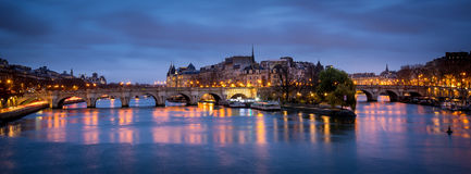 Ile de la Cite and Pont Neuf at dawn - Paris. Dawn on a cloudy morning in Paris, France with Ile de la Cite and Pont Neuf. The Seine River reflects the violet stock photography