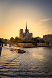 Ile de la Cite and River Seine in Paris. A sightseeing boat on River Seine and Notre Dame cathedral in Paris, France Royalty Free Stock Photos