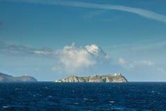 Ile de la Giraglia en la extremidad septentrional de Cap Corse Fotos de archivo libres de regalías