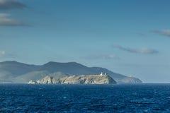 Ile de la Giraglia på den nordliga spetsen av Cap Corse Arkivfoton