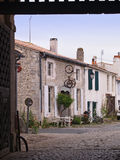 Ile de Re. The Island of Re is a famous holiday resort on the Atlantic coast, the island has its fair share of celebrities, past and present. An empty street in Stock Photography