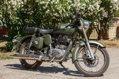 Indian Royal Enfield 500 Classic in Military Green color parked. Ile de re, France - August 22, 2016 : Indian Royal Enfield 500 Classic in Military Green color Royalty Free Stock Photo