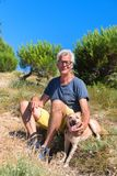 Ile de Re - Man and dog in La Couarde sur Mer royalty free stock image