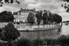 Ile Saint Louis and River Seine, Paris. Black & White Photography. Ile Saint-Louis and the Seine river bank on this quiet eastern tip of the island. Ile St Louis Royalty Free Stock Image