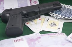 Ilegal poker game with guns on the table Royalty Free Stock Photography