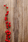 Ilex verticillata (winterberry) on wooden table Royalty Free Stock Photography
