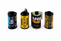 Ilford and Kodak 35mm film. Type of 35mm Ilford and Kodak film for black and white and color on white background Royalty Free Stock Photo