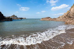 Ilfracombe Devon England. Waves crashing on Rapparee Cove Beach, Ilfracombe Devon England UK Stock Image