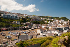 Ilfracombe Harbour. With houses and boats on the mud in a sunny day - South West (UK) 07/2015 royalty free stock image