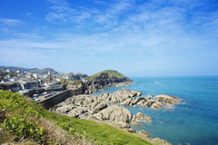 Ilfracombe on the North Devon coast, England. Ilfracombe is a seaside resort and civil parish on the North Devon coast, England with a small harbour, surrounded stock photo