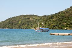Ilha Grande: Sailboat at coastline near Praia Lopes Mendes, Rio de Janeiro state, Brazil Royalty Free Stock Images