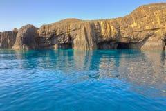 Ilhotas rochosas de Glaronisia, Milos, Greece Imagem de Stock