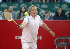 Ilie Nastase. Former tennis player Ilie Nastase pictured with an old school racket during a charity tennis game held during BRD Nastase-Tiriac Trophy Stock Photos