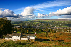 Ilkley from Ilkley Moor. A view of Ilkley in Wharfedale, Yorkshire, England, from Ilkley moor, showing the White Wells bath house and cafe stock photo