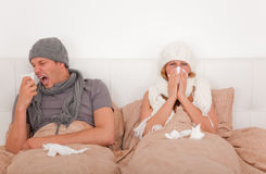 Ill bed couple Royalty Free Stock Images