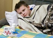 Ill boy Stock Image