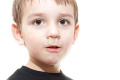 Ill boy with flu and green rhinitis Royalty Free Stock Photography